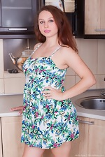 Adelia Rosa strips naked in her kitchen