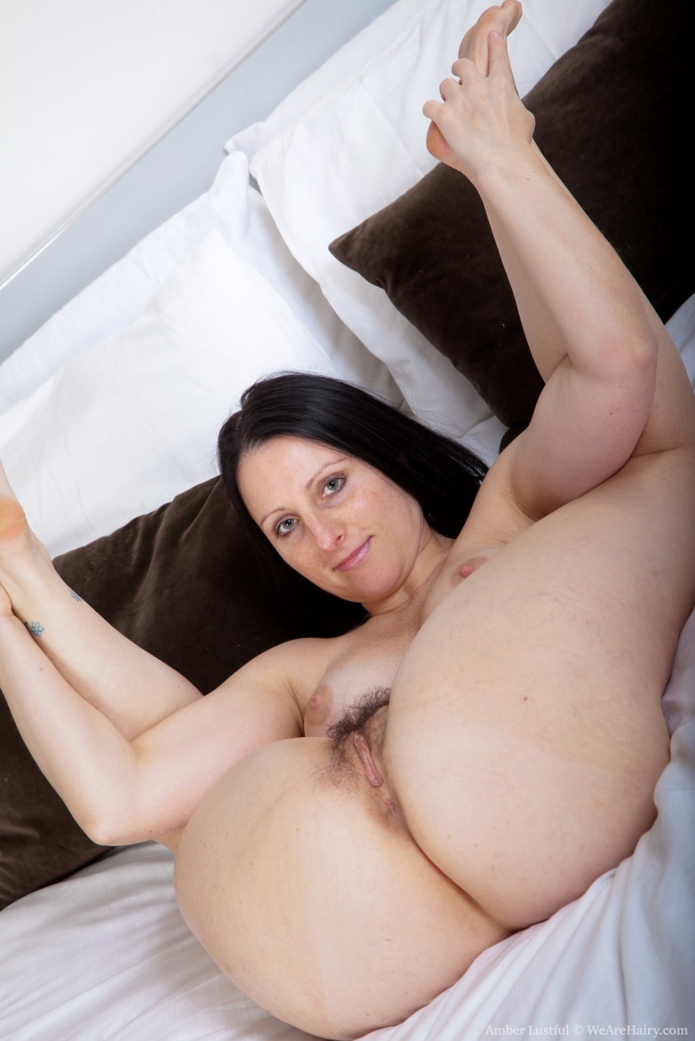 Beautiful milf laying on a bed 6