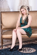 Anna Belle models and strips off her green dress