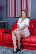 Anna Smith strips and plays nude on her red couch