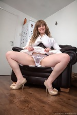 Betty Busen strips naked on her leather chair