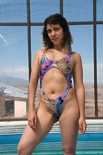 Christal strips naked outside by her pool