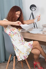 Elena V masturbates with a vibrator at her desk