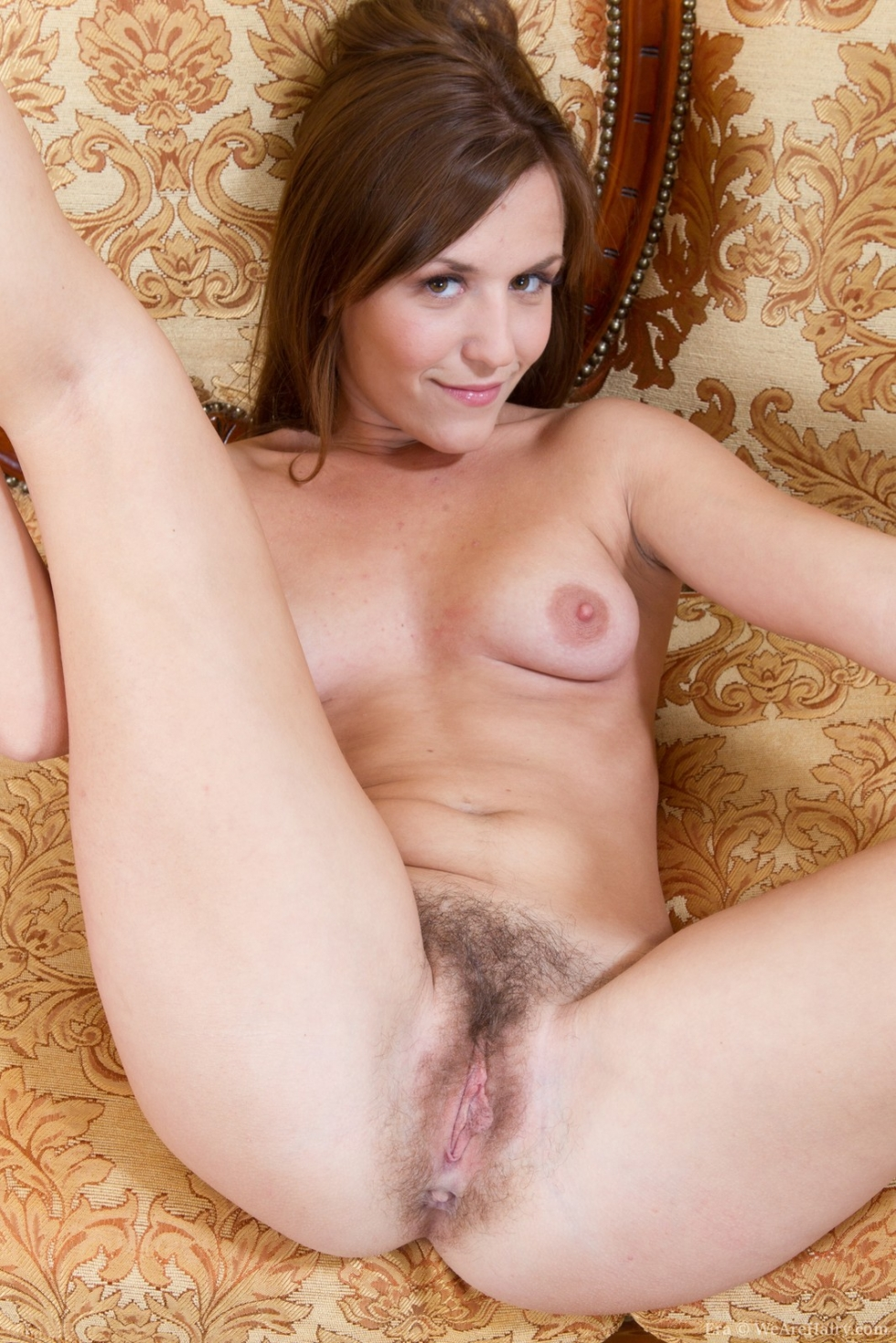 image Nina strips and spreads her hairy muff