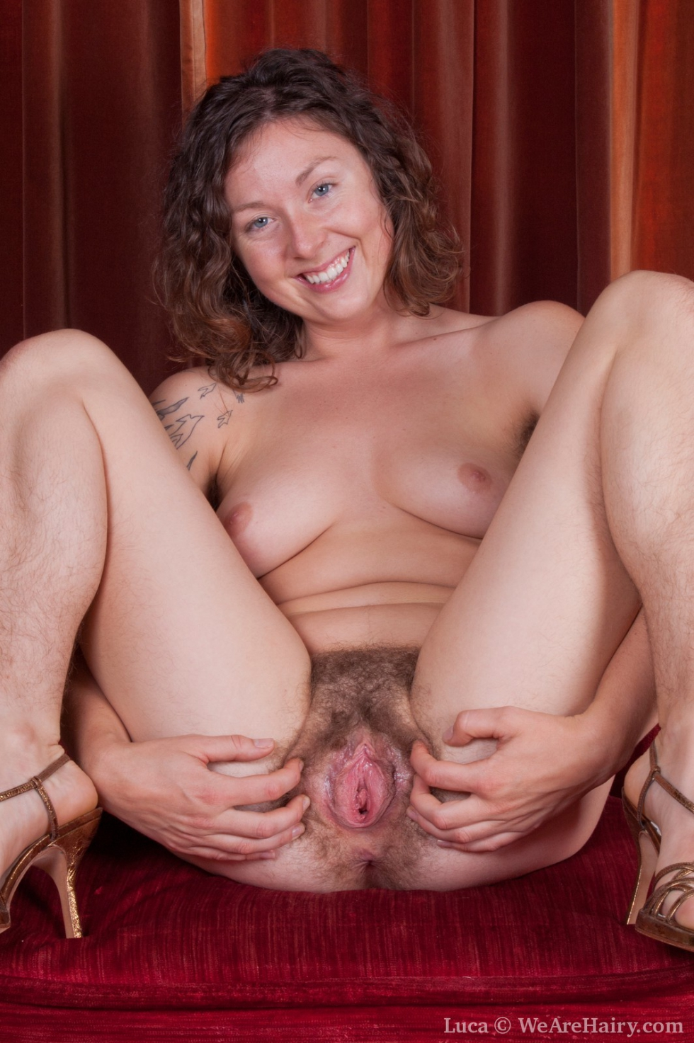 Hairy pussy sitting on chair