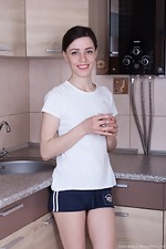 Maria Rosa gets naked in her kitchen