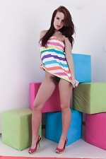 Promesita strips from her striped dress to play