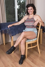 Serai slowly undresses on chair showing hairy body