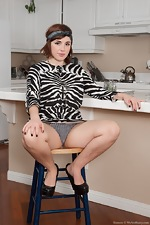 Stripping in the kitchen makes Simone horny