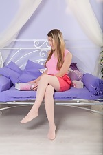 Stella strips from stockings to masturbate alone