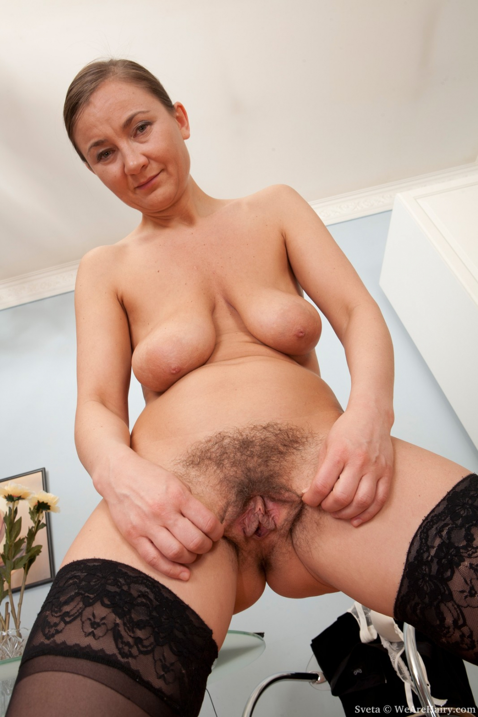 image Hairy mature with big tits and trimmed pussy riding cock