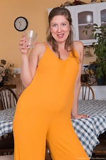 Valentine models a sexy orange jumpsuit