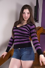 Virgin is perfect in purple as she plays with self
